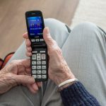 Older person looking at a mobile phone